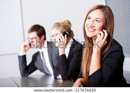 Business people having phonecall in meeting - stock photo