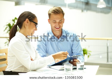 Business people holding a positive discussion to achieve better results - stock photo