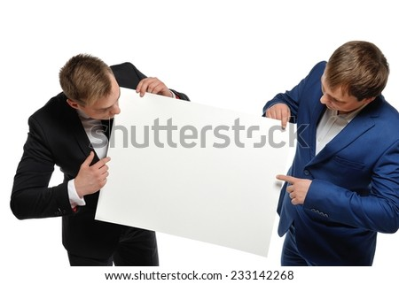 Business people holding and pointing a poster against white background. - stock photo