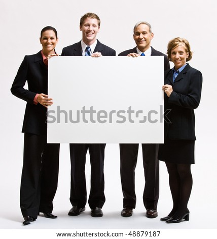 Business people holding blank paper - stock photo