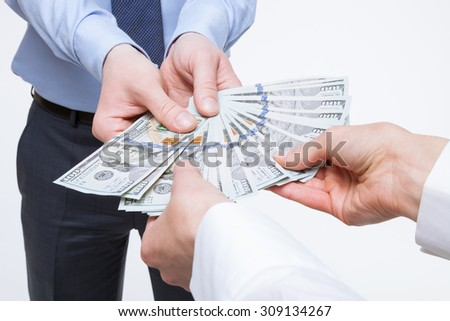 Business people holding dollars, closeup shot