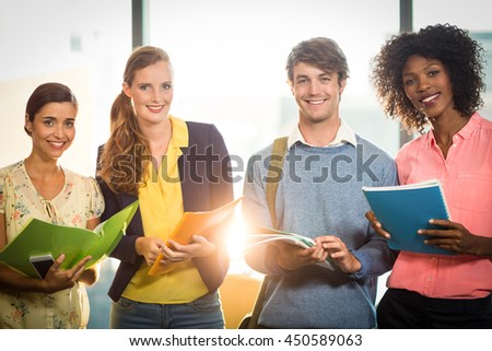 Business people holding files in office