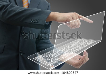 Business people holding finger on glass laptop touch screen.