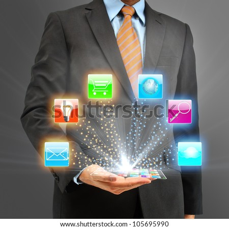 Business people holding glass phone with icon - stock photo