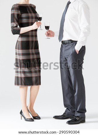 Business people holding goblets of wine, white background - stock photo