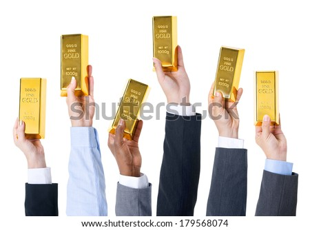 Business People Holding Gold Bars - stock photo
