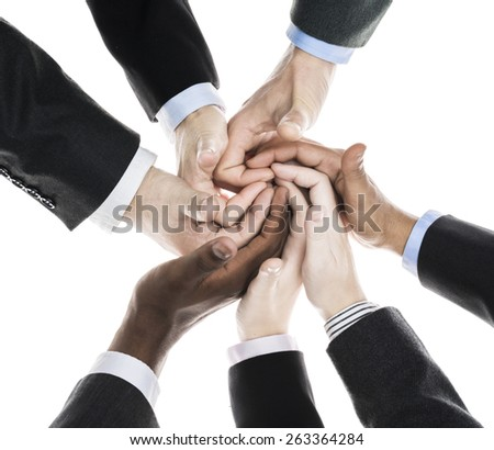 Business people holding hands - stock photo