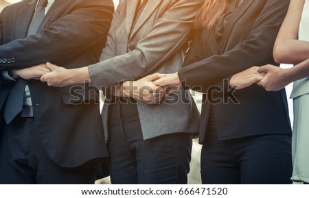 Business people holding hands together showing teamwork, people unity, corporate for businesses success.