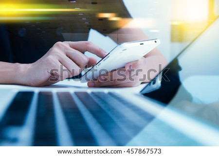 Business people holding mobile phone about research data or document for discuss business planning market with film effect and copy space.