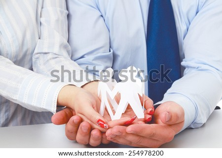 Business people holding paper people - stock photo