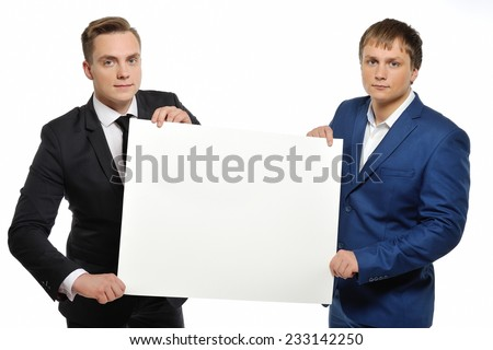 Business people holding poster against white background. - stock photo
