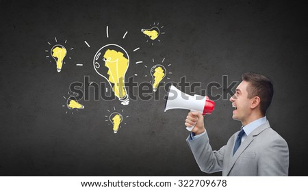 business, people, idea and announcement concept - happy businessman in suit speaking to megaphone and light bulbs over dark gray concrete wall background - stock photo