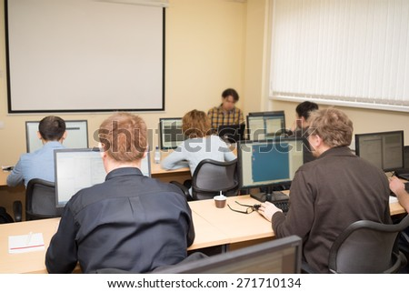 Business people in a computer class - stock photo