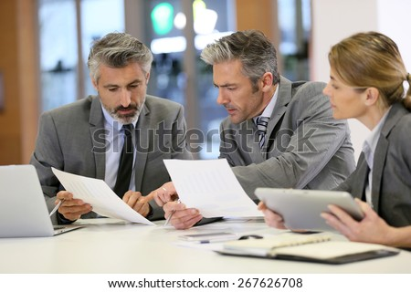 Business people in a financial meeting - stock photo