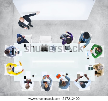 Business People in a Meeting with Empty Presentation - stock photo