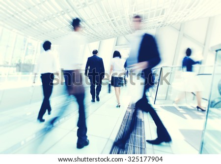 Business people in Asia. Hong Kong. Tilt shift lens with selective focus, Blurred motion. Blue tint. - stock photo