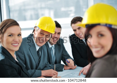 Business people in conference room talking about future plans - stock photo