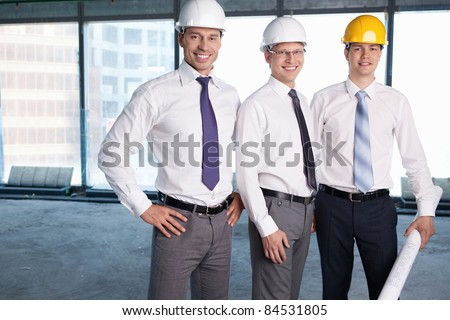 Business people in hard hats at construction site