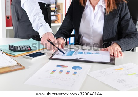 Business people in meeting talking about business performance - stock photo