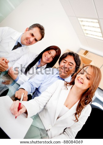 Business people in meeting with doctors signing a contract on medical insurance - stock photo