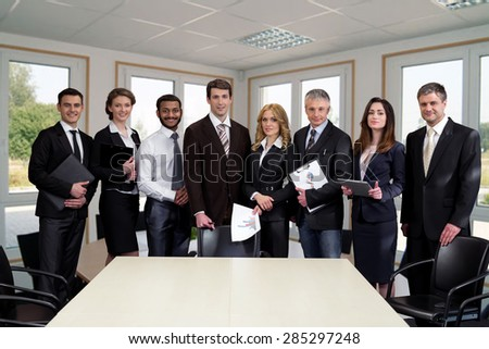 Business people in modern light office. Successful managers. - stock photo