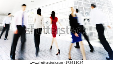 Business people in motion. - stock photo