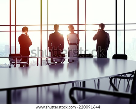 business people in office against background of sky - stock photo
