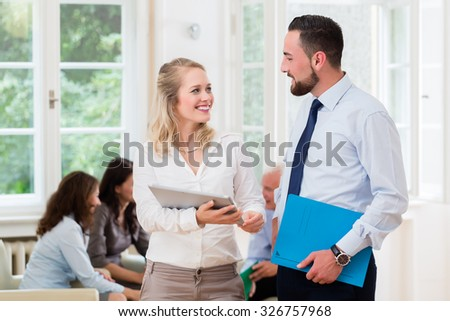 Business people in office having informal meeting and short presentation - stock photo