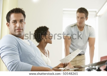 Business people in office meeting, portrait - stock photo