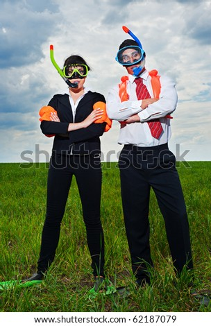 business people in scuba mask and flippers going to vacation