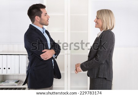 Business people in suit and dress talking together: small talk. - stock photo