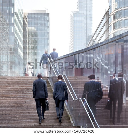 Business people in the office center. Urban scene. - stock photo