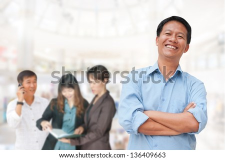 Business people in the studio, cheerful and motivated on the background of business people