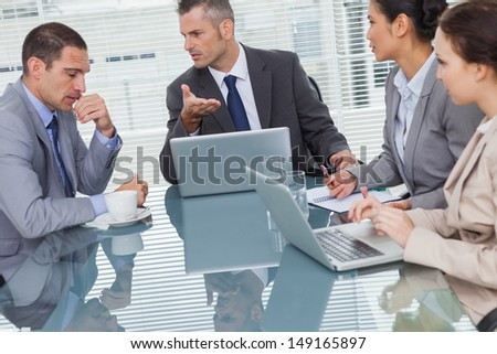 Business people interacting and working together in bright office