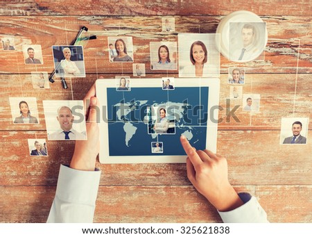 business, people, international communication, headhunting and technology concept - close up of hands pointing finger to tablet pc computer screen with world map and internet contacts network on table - stock photo