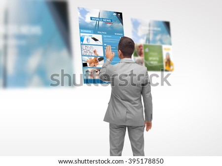 business, people, internet and mass media concept - businessman touching virtual projection with world news web page from back