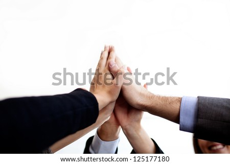 Business people joining hands together isolated. - stock photo