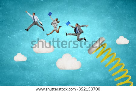 Business people jumping on springboard as progress concept