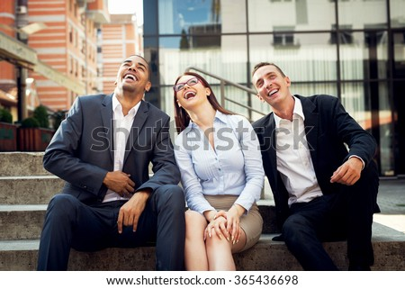 Business people laughing.
