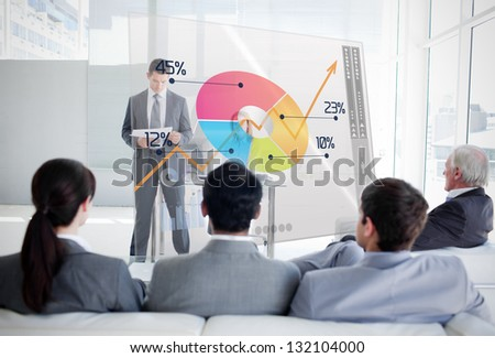 Business people listening and looking at colorful pie chart interface in a meeting - stock photo
