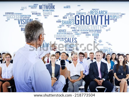 Business People Listening to a Business Presentation - stock photo