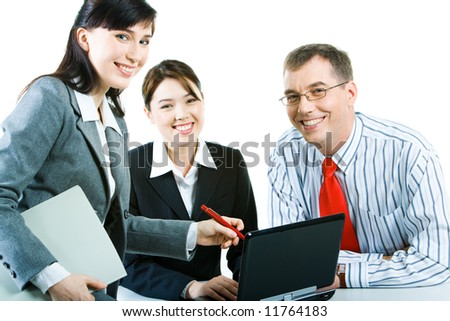 Business people looking at camera during discussing a computer work - stock photo