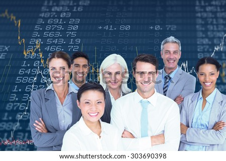 Business people looking at camera with arms crossed against stocks and shares - stock photo