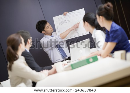 Business people Looking at Graph