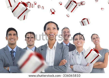 Business people looking up in office against white and red gift box - stock photo