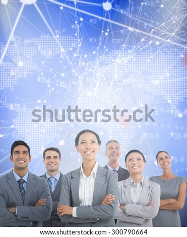 Business people looking up in office against world map with stocks figures - stock photo