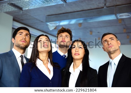Business people looking up with dreaming expression