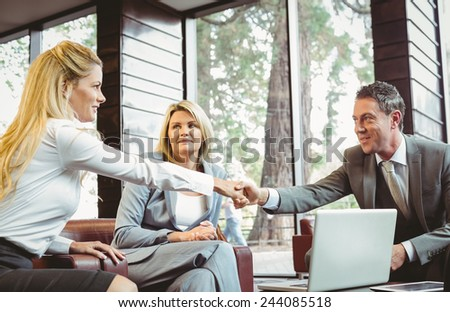 Business people making a deal at a meeting in the office - stock photo
