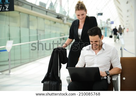 business people man and woman sitting in public station and working with computer in public wifi area