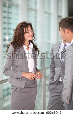 Business people meeting in a hall - stock photo